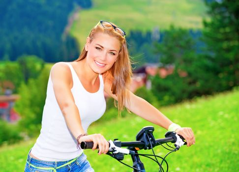 Riding on bicycle in Alpine mountains