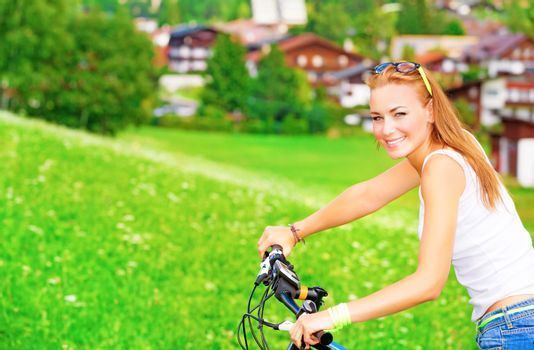 Sportive teen girl riding on bicycle