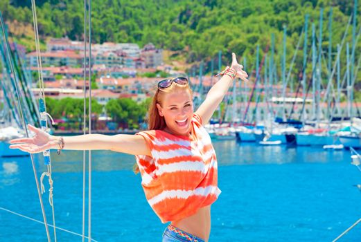 Happy woman at yacht port