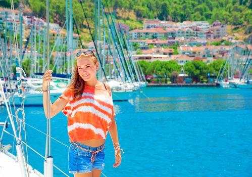 Cute girl in yacht harbor