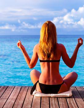 Yoga exercise on seashore