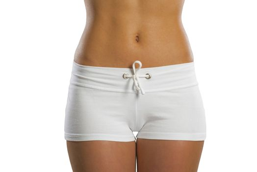 image of an abdomen and thighs athletic young woman