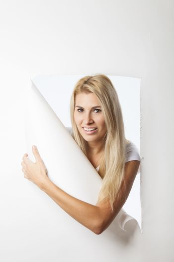 woman looking through seamless paper