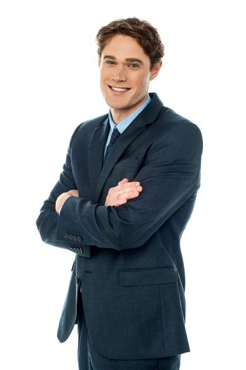 Smiling businessman with folded arms