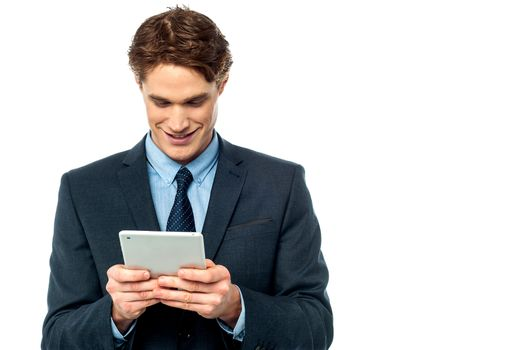 Smiling businessman using a tablet pc