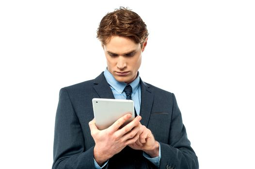 Smiling young businessman using touchpad