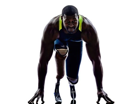 handicapped man runners sprinters  with legs prosthesis  silhoue