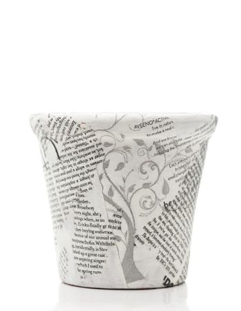 News paper decorated flower pot on white background