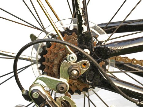 Close up of rusty bicycle gears and chain.