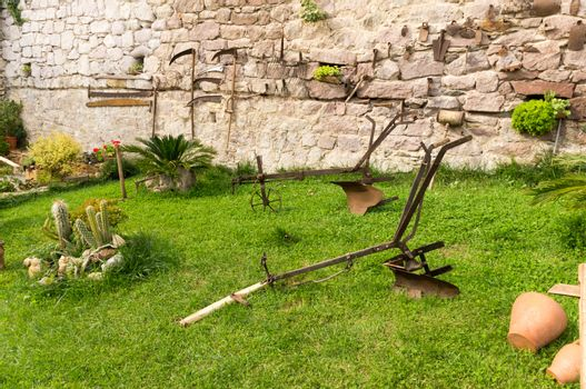 Plow and old gardening tools