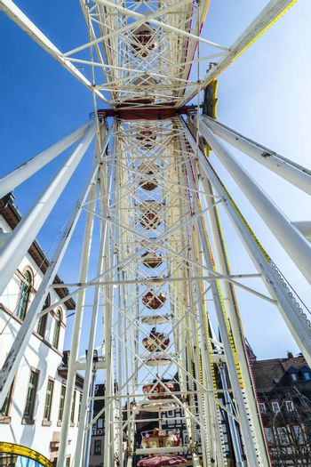 GELNHAUSEN, GERMANY - MARCH 9. people enjoy the 24th Barbarossamarkt festival with big wheel on March 9, 2014 in Gelnhausen, Germany. The annual event lasts 4 days and takes place all over the city.