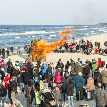 ZINNOWITZ, GERMANY - APRIL 19: people watch the easter fire on April 19, 2014 in Zinnowitz, Germany. Easter fire at the beasch is an ols tradition in Usedom.
