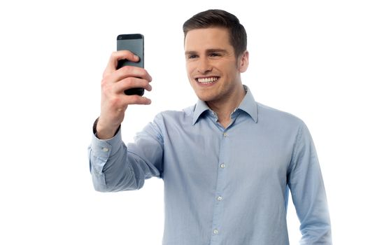 Young man browsing in mobile phone