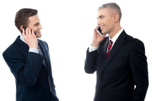 Young businessmen with cell phones