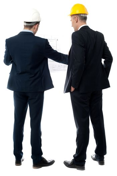Businessmen analyzing construction plan