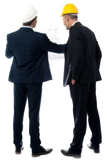 Architects discussing their building plan