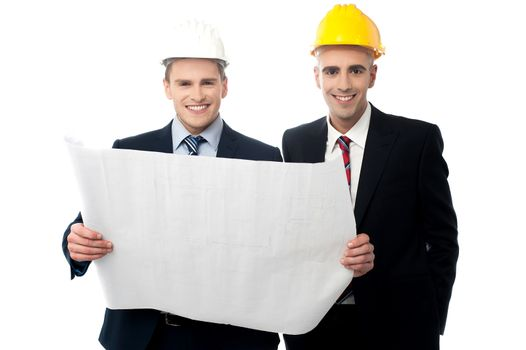 Civil engineers reviewing construction plan