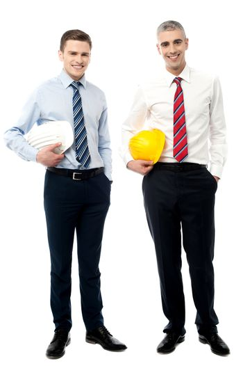 Two businessmen with hard hats