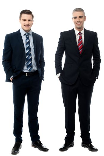 Successful businessmen posing in style