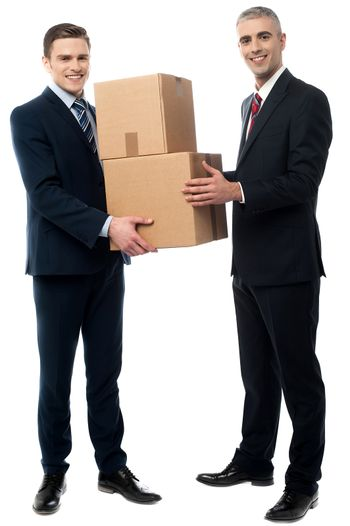 Male executives posing with cardboard boxes
