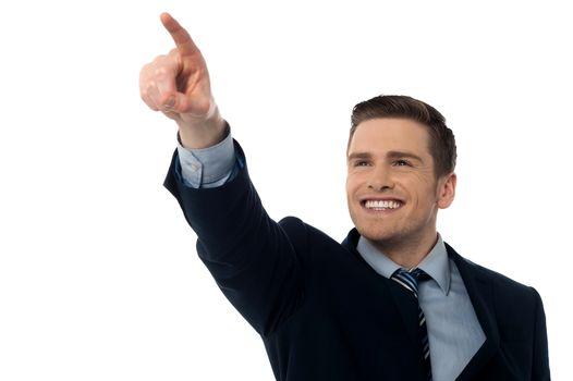 Smiling businessman showing something