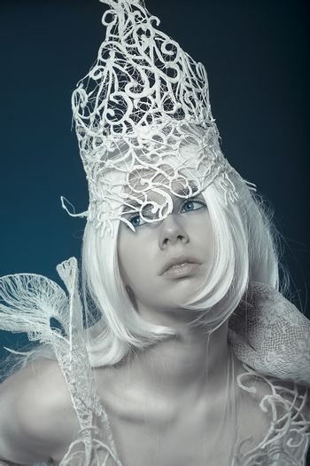 Queen. Beautiful model with long white hair and vintage corset