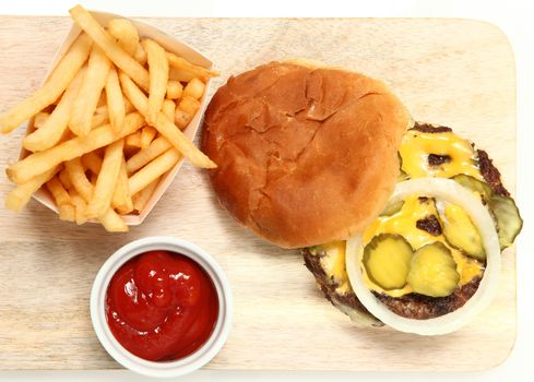 Top View Burger and Fries on Cutting Board