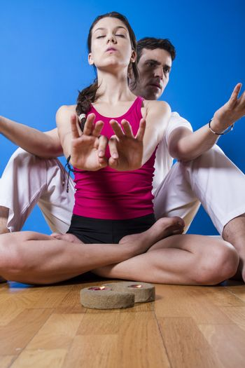 Young man and woman practicing yoga and meditation