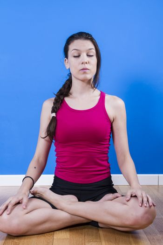 Beautiful woman practicing yoga and meditation