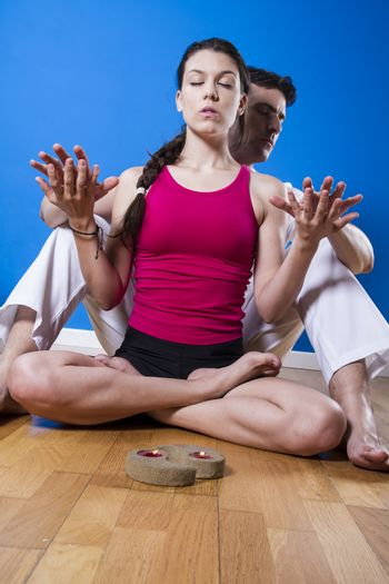 Relax, Young man and woman practicing yoga and meditation