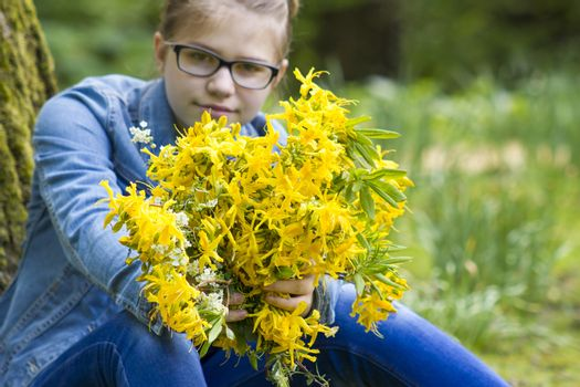 young girl with big bouquet of spring flowers
