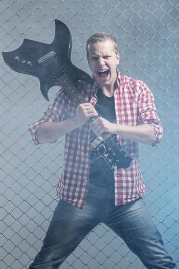 Aggressive musician with a guitar