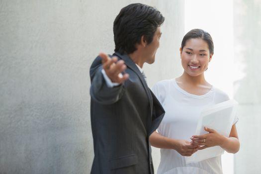 Estate agent showing buyer around