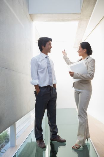 Estate agent speaking with potential buyer
