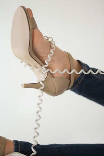 Phone cord wrapped around womans foot