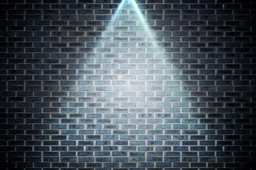 Grey brick wall under spotlight
