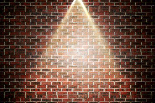 Red brick wall under spotlight