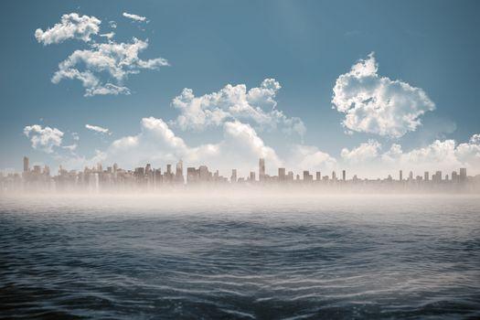 Cityscape on horizon over ocean