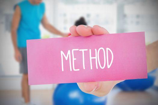 Woman holding pink card saying method