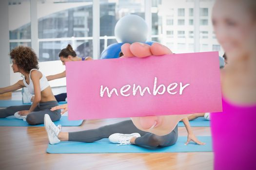 Fit blonde holding card saying member
