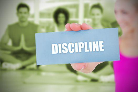 Fit blonde holding card saying discipline
