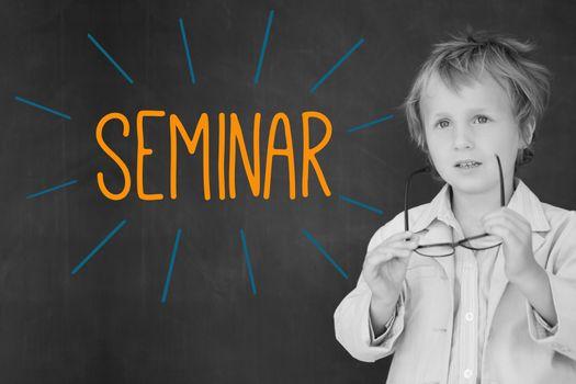 Seminar against schoolboy and blackboard