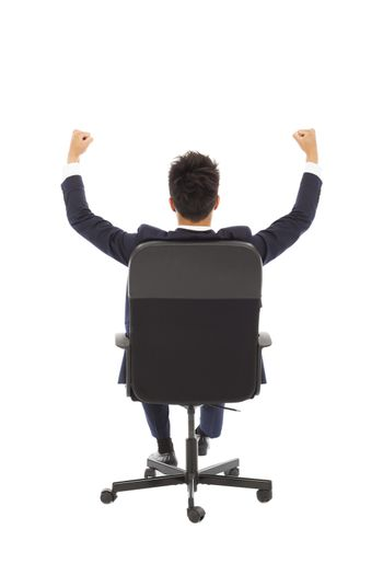 successful businessman with hands up