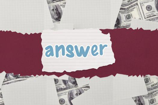 Answer against white paper strewn over dollar bills