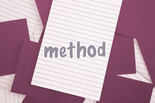 Method against purple paper strewn over notepad