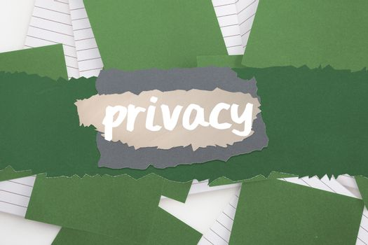 Privacy against green paper strewn over notepad