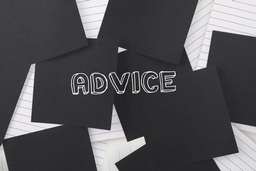 Advice against black paper strewn over notepad