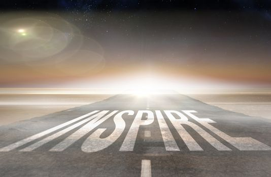 Inspire against road leading out to the horizon