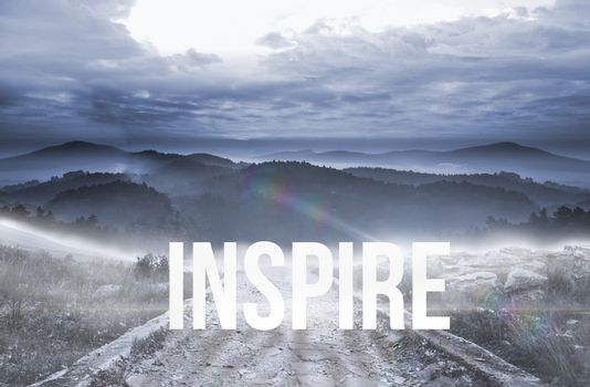 Inspire against stony path leading to large misty mountains