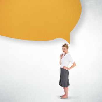 Thinking businesswoman with speech bubble against white wall